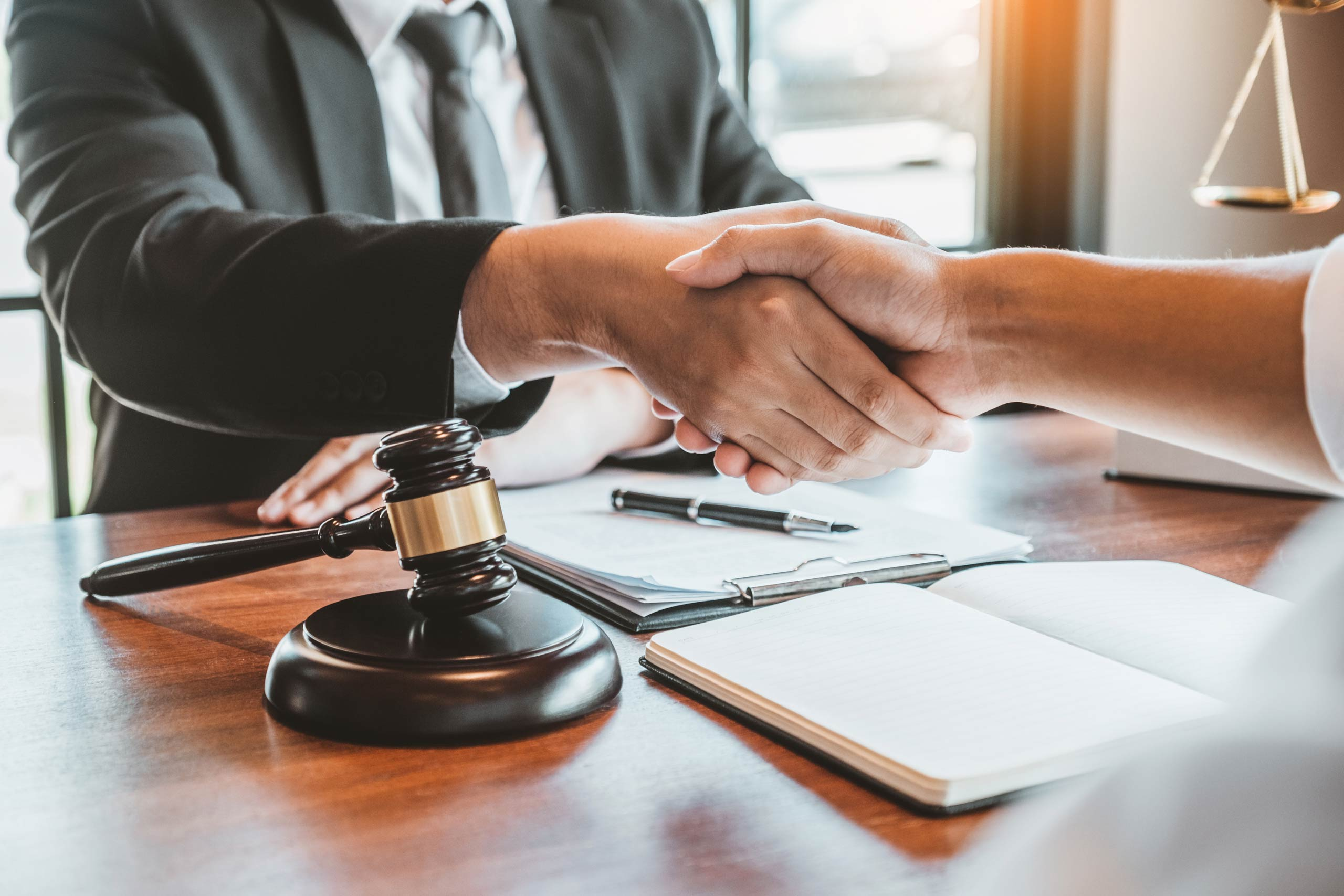 a lawyer and client shaking hands